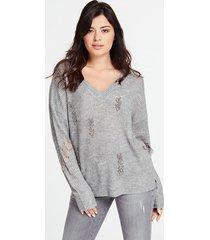 sweter z cekinowymi aplikacjami