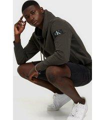 calvin klein jeans monogram badge hoodie tröjor grey