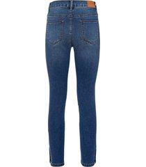 skinny jeans met knopen onder op de pijpen