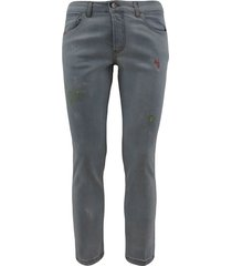 5-pocket light wash denim jeans with abrasions and paint