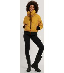 na-kd trend quiltad croppad jacka - yellow