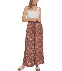 black tape floral-print wide-leg pants