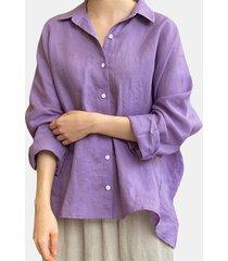 camicetta asimmetrica da donna con colletto rovesciato a maniche lunghe tinta unita