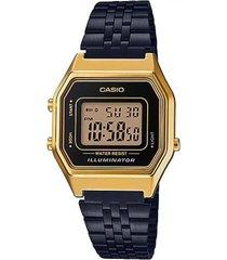 reloj vintage mediano dorado con negro