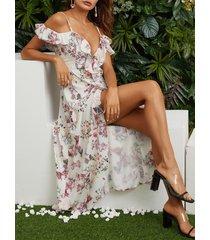 a media pierna con espagueti sin espalda y estampado floral blanco vestido