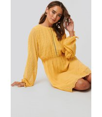 na-kd boho lace-up back mini dress - yellow
