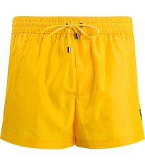 dolce & gabbana dg embroidered swim shorts - yellow
