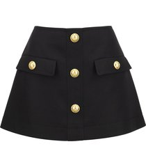 balmain mini skirt with gold embossed buttons