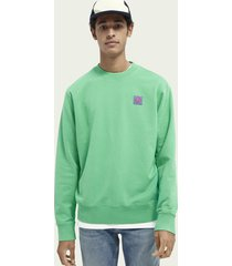 scotch & soda garment-dyed katoenen sweater met artwork