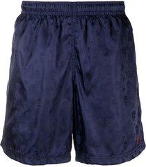 alexander mcqueen skull-pattern swim shorts - blue