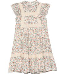 bubbie ditsy short sleeve tiered tunic dress in multi
