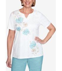 alfred dunner short sleeve asymmetric flower applique knit top