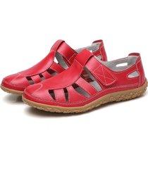 sandali in pelle traforata con velcro