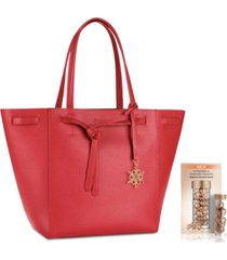 receive a free red tote bag and 7-day vitamin c ceramide capsules with any $74 elizabeth arden purchase