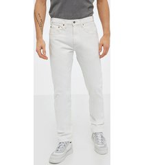levis 502 taper toothy white jeans neutral
