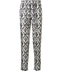 dolce & gabbana all-over print trousers - white
