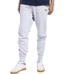 pantalón gris reebok cl vector