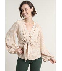 blusa feminina estampada animal print com nó e botões manga longa bufante bege claro