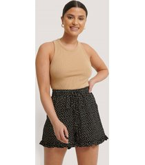 na-kd dotted frill hem shorts - black