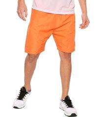 pantaloneta deportiva naranja jogo