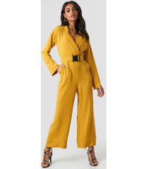 hoss x na-kd belted wrap front jumpsuit - yellow