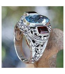 blue topaz and garnet cocktail ring, 'limpid pool' (indonesia)