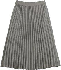 lång, plisserad kjol med hundtandsmönster