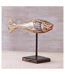 wood statuette, 'lone swimmer' (indonesia)