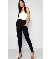 zwangerschap getailleerde broek met smalle pijpen, zwart