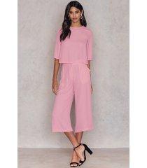 na-kd flared culotte pants - pink