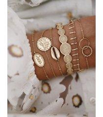 pulsera de seis piezas con monedas de oro, concha y aro de hoja