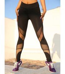 leggings negros con cinturilla elástica de patchwork de malla doble