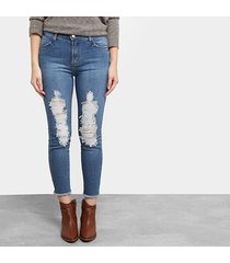 calça jeans skinny mob estonada rasgada cintura média feminina