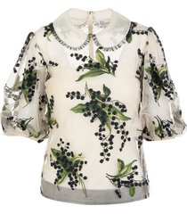 off-white blouse with floral pattern
