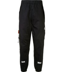 aape by *a bathing ape® zipped track pants - black