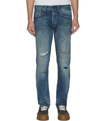 'razor' rip-and-repair washed slim jeans