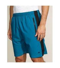 bermuda masculina esportiva ace com bolso de z¡per e faixa lateral em tela verde