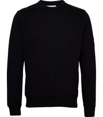 monogram badge crew neck gebreide trui met ronde kraag zwart calvin klein jeans