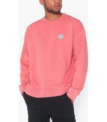 nudie jeans lukas logo tröjor rosa