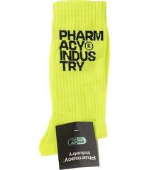 pharmacy industry woman fluo yellow socks with black logo