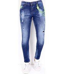 skinny jeans local fanatic broek gaten en verfspatten