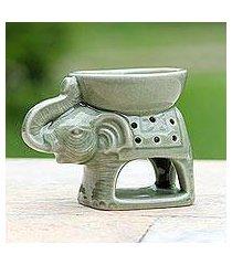 ceramic oil warmer, 'welcome elephant' (thailand)