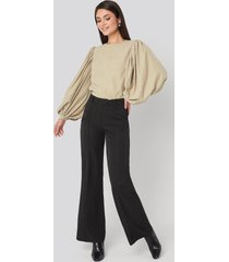 na-kd trend fold up flared pants - black