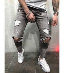 pantalones de mezclilla desgastados con cremallera rasgada para hombre