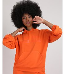 """blusão de moletom feminino oversized """"the sum will rise"""" com bolso e capuz laranja"""
