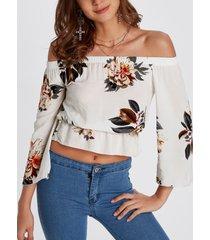blusa con hombros descubiertos y estampado floral al azar con correa elástica blanca