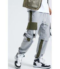 koyye hombre moda color block patchwork bolsillo con solapa carga pantalones