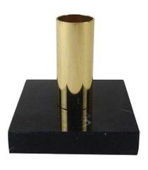castical dourado com base de mármore preto