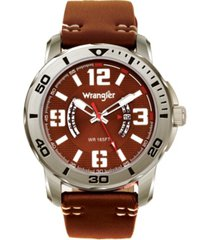 wrangler men's watch, 48mm silver colored case with black printed arabic numerals on outer steel bezel, brown dial with dual crescent windows, date window, brown strap with white accent stitch analog