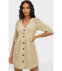 glamorous buttoned v neck dress klänningar